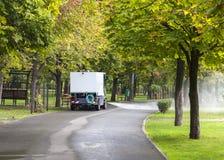 Bearbeta med maskin att rengöringar parkera Royaltyfri Bild