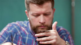 Beard barber making haircut to hipster stock video footage