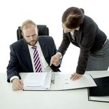 Beard business man brunette woman at desk Royalty Free Stock Images