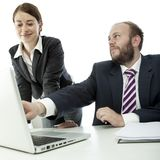 Beard business man brunette woman at desk Stock Image