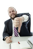 Beard business man at desk thumb down Royalty Free Stock Images
