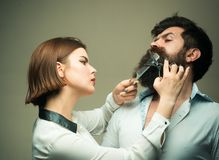 Beard care tricks keep facial hair look resplendent. Choose final style. Match beard to your face shape. Girl barber. With scissors cutting hair of brutal stock photo