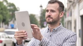 Beard casual man using tablet outdoor. 4k high quality, 4k high quality stock footage