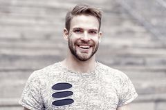 Beard divides the boy from the man. Handsome man with sexy smile on unshaven face and stylish blond hair. Happy stock photography