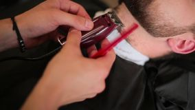 Beard haircut in the barbershop stock video