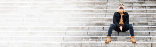 Beard handsome man on a stairs Stock Image