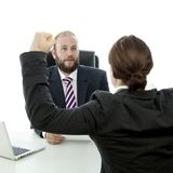 Beard man and brunette woman arms air. Beard business men brunette women at desk arms in the air Stock Photography