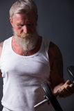 Beard Man with dumbbell Royalty Free Stock Photography