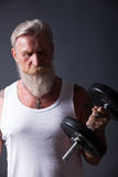 Beard Man with dumbbell Royalty Free Stock Images