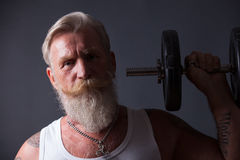 Beard Man with dumbbell Royalty Free Stock Image