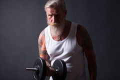 Beard Man with dumbbell Royalty Free Stock Photo