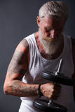 Beard Man with dumbbell Stock Photography