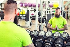 Beard man with dumbbells. Beard men with long hair exercising with dumbbells Royalty Free Stock Photo