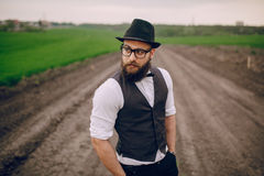 Beard man in field lonley Stock Photos