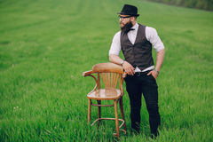 Beard man in field lonley Royalty Free Stock Image