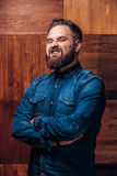 Beard man grinning on wooden texture royalty free stock photos