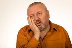Beard man is having toothache Stock Photo