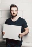 Beard man hold white empty card blank mock-up Stock Photography