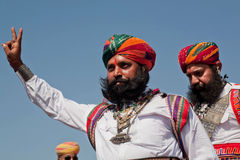 Beard man in indian dress show the victory sign Stock Photos