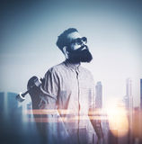 Beard man with longboard and sunglasses on blurred city backgrou Royalty Free Stock Images