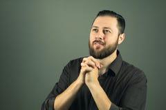 Beard man praying. Religious life. Indoor portrat stock images