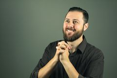 Beard man praying. Religious life. Indoor portrat royalty free stock photography