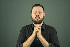 Beard man praying. Religious life. Indoor portrat royalty free stock images