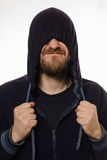 Beard man pulled a hood over his eyes and smile Royalty Free Stock Image