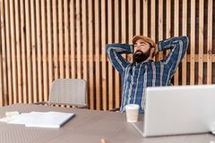 Beard man relax on modern workplace. Coffee break, success. Copy space for text