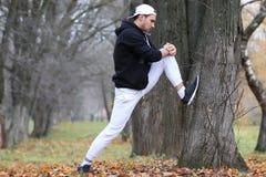 Beard man sport in autumn park stock image