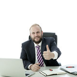 Beard man thumb up at desk Royalty Free Stock Photography