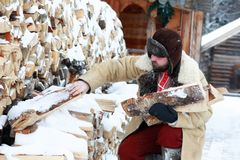 Traditional winter costume of peasant medieval age in russia. Beard man in traditional winter costume of peasant medieval age in russia royalty free stock images
