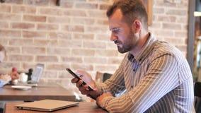 Beard Man Using Smartphone, Text Messaging stock footage