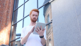 Beard Man Using Tablet for Browsing, Standing Outside Office Stock Photos