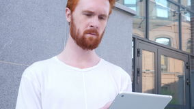 Beard Man Using Tablet for Browsing, Standing Outside Office. Creative designer , businessman stock footage