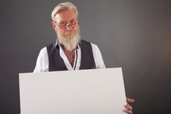 Beard man with a white board Royalty Free Stock Images