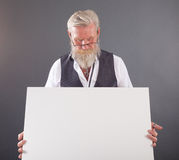 Beard man with a white board Royalty Free Stock Photography