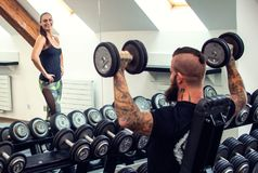 Beard man with dumbbells. Beard men with long hair exercising with dumbbells Royalty Free Stock Photography