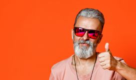 Beard old man is showing thumbs up stock images