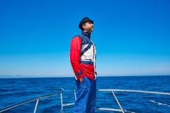 Beard sailor cap man sailing sea ocean in a boat Stock Image