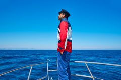 Beard sailor cap man sailing sea ocean in a boat Stock Photography