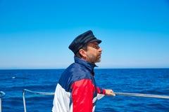 Beard sailor cap man sailing sea ocean in a boat Royalty Free Stock Photo