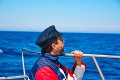 Beard sailor cap man sailing sea ocean in a boat Royalty Free Stock Images