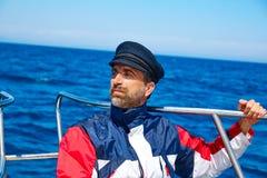 Beard sailor cap man sailing sea ocean in a boat Stock Images