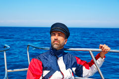 Beard sailor cap man sailing sea ocean in a boat Royalty Free Stock Photo