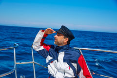 Beard sailor cap man sailing sea ocean in a boat Royalty Free Stock Images