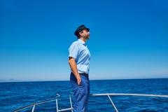 Beard sailor cap man sailing sea ocean in a boat Stock Photo