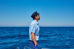 Beard sailor cap man sailing sea ocean in a boat Royalty Free Stock Image