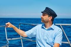 Beard sailor cap man sailing sea ocean in a boat Royalty Free Stock Image