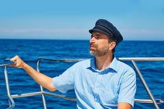 Beard sailor cap man sailing sea ocean in a boat Stock Image